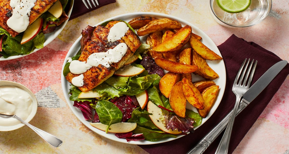Seared Barramundi and Horseradish Sauce with Seasoned Potato Wedges and Apple Salad